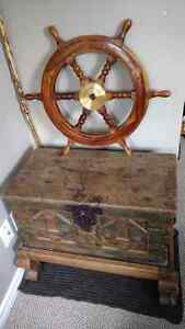 Hardwood treasure chest, stand and real antique ships wheel.