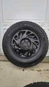 P215/70R15 97T.  4 Hankook winter i pike RS w rims. LIKE NEW