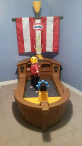 Little tikes pirate ship toddler bed.  Includes mattress.