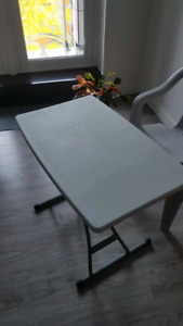 Small table and plastic chair