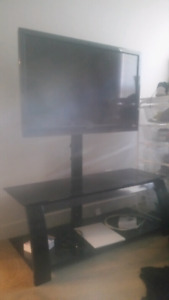 Selling  Sony TV and TV stand together