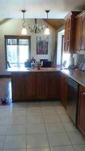 **Solid oak custom kitchen cabinets with countertop and sink.