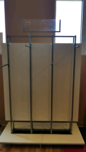 Retail clothing rack.  Two sided.