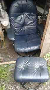 dark blue leather reclining chair with matching footstool