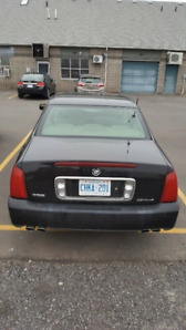 SACRIFICE SALE! LOW KILOMETERS, RELIABLE, SMOOTH RUNNING DEVILLE
