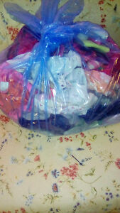 Bag of baby girl clothes. 6-9 months.