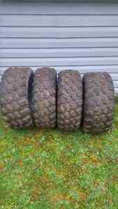 Four 14 inch maxxis atv tires
