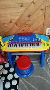 Kids Piano with stool.