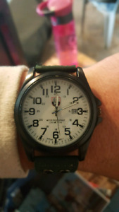 Military watch with green leather wristband