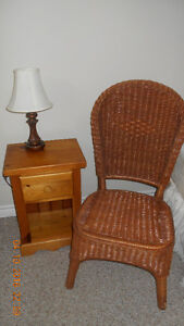 Night table and wicker chair.