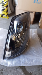 Volvo 82329127/82329124 head lights $100 each