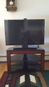 32 inch DYNEX  TV with 3 shelf stand and remote