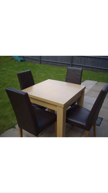 Oak Extendable Dining table in good conditionin Edgbaston, West MidlandsGumtree - For sale is our Oak dining table with 4 faux leather chair set in good condition. The table is extendable. Looks nice and its in good condition. Selling as moving house. Only £80 for the set of chairs and table