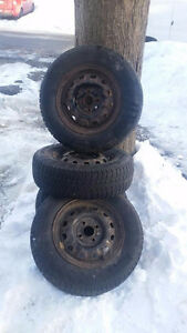 4 winter tires. 185/70/R13 on the rims. $50 OBO.