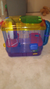Hamster cage, bedding, and accessories