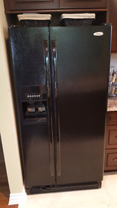 Black side by side fridge with water and ice