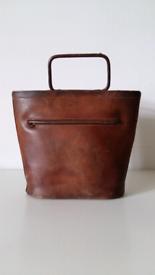 Tan leather bag.