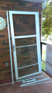 Storm Door 36 x 80 with full view and auto-screen.