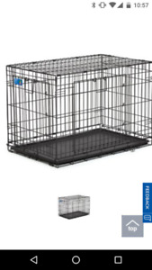 Dog crate for sale.