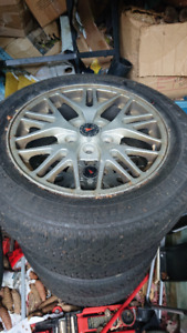 Set of winter tires on 17 inch 5 bolt Pontiac aluminum rims