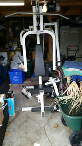 UNIVERSAL GYM -WEIGHT PLATE & CABLE SYSTEM