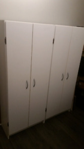 Two matching  white storage cabinets