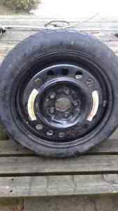 Spare tire on Nissan Altima rim