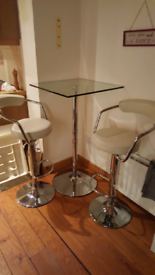 Glass Breakfast Table and Swivel Barstools