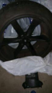 22 black rims with tires