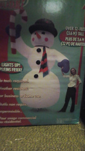 12 foot tall inflatable  snow man brand new in box