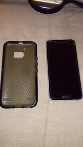 HTC M10  WITH CASE AND CHARGER $475.00 519-502-1370