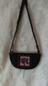 Mini purse dark brown suede long strap nice gold silk inside.