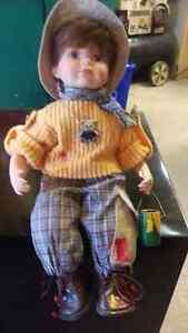 Painter boy porcelain doll