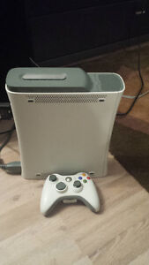 xbox 360, one controller, 60GB, 17 games. Great X-mas present