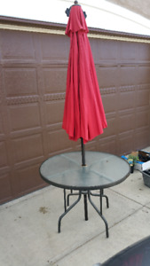 Outdoor Table with Red Umbrella and Umbrella Stand
