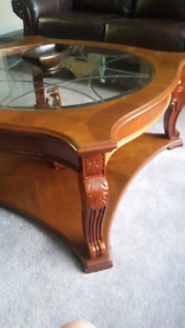 beautifully carved coffee table and sofa table