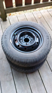 """15"""" steel Rims with Tires on for sale ( winter and all season)"""