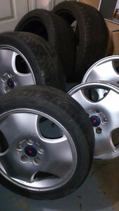 "16"" Saab rims with tires! MUST SELL, GOING OVERSEAS."