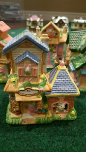 14 piece Easter figurines collection. Bunnies and houses