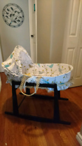 Moses basket with canopy on rocking stand