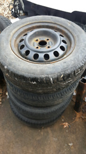 2000 Toyota Corolla all season tires, steel wheels