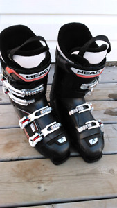 Downhill skis, boots and helmet