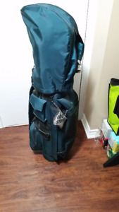 Left golf clubs with bag and caddy