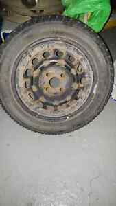 WINTER TIRES EXCELLENT CONDITION WITH RIMS NEGOTIABLE West Island Greater Montréal image 1