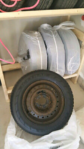 """15"""" winter tires on rims. Set of 4!!!!"""