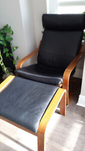 black Ikea leather chair with foot stool