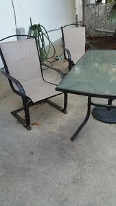 Glass patio table w/4 chairs