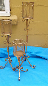 3 gold candle holders