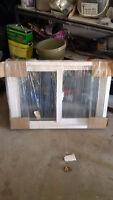 Gentek Basement slider window 25 1/4 x 64 1/2