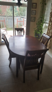 Dining Table with 2 leafs. $200.00 with 4 chairs